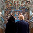 Donald Trump and his wife Melania visit the Sistine Chapel. Photo: Getty