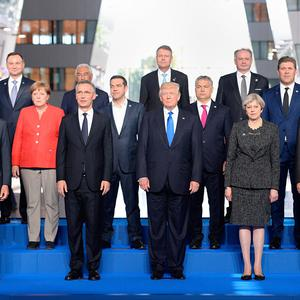 German Chancellor Angela Merkel, (fifth left) and (front row second left to right) NATO Secretary General Jens Stoltenberg, US President Donald Trump, Prime Minister Theresa May and President of Turkey Recep Tayyip Erdogan, during the North Atlantic Treaty Organisation (NATO) summit on May 25, 2017 in Brussels, Belgium. Photo: Getty Images