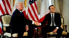 US President Donald Trump shakes hands with French President Emmanuel Macron before the Nato summit in Brussels yesterday. Photo: Reuters/Peter Dejong