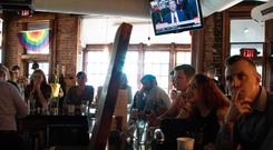 Spectators and patrons at Shaw's Tavern in Washington, DC, watch as former FBI director James Comey testifies before the Senate Intelligence Committee. Photo: Getty Images