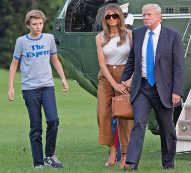 US President Donald Trump, first lady Melania Trump and their son Barron Trump arrive at the Andrews Air Base in Washington, DC, yesterday. Photo: Getty Images