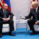US President Donald Trump offers a handshake to Russian President Vladimir Putin at the G20 summit. Photo: AP