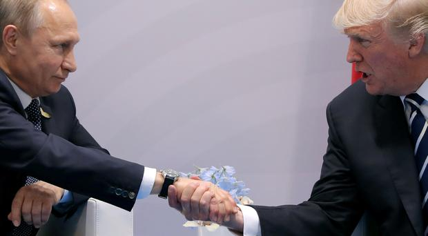 Donald Trump shakes hands with Vladimir Putin during their bilateral meeting at the G20 summit in Hamburg, Germany. Photo: Carlos Barria/Reuters