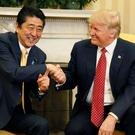 Japanese Prime Minister Shinzo Abe with Donald Trump. Photo: Reuters