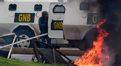 Members of the National Guard under attack by protesters in Venezuela's third city, Valencia, Photo: Getty