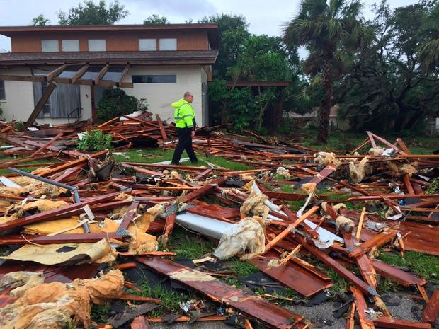 A local worker walks through debris of what used to be a two-storey home in Brevard County, Florida. Photo: AP