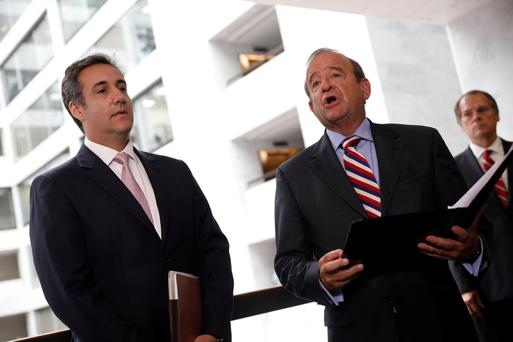 Michael Cohen listens as his own lawyer Stephen Ryan (right) talks to reporters after meeting with the Senate Intelligence Committee investigating Russian interference in the election. Photo: REUTERS
