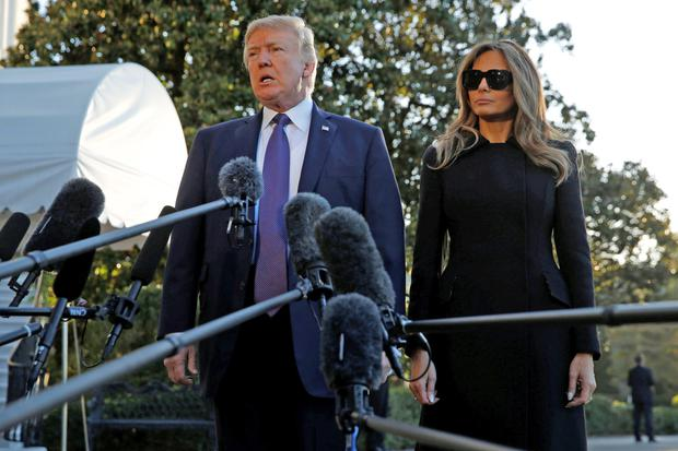 US President Donald Trump speaks to reporters as he and First Lady Melania Trump depart from the South Lawn of the White House in Washington to travel to Las Vegas in the aftermath of the shooting on the Strip. Photo: Jonathan Ernst/Reuters