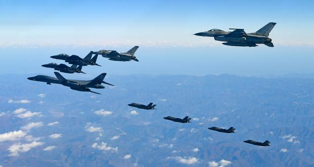 A US B-1B bomber and fighter jets over the Korean Peninsula
