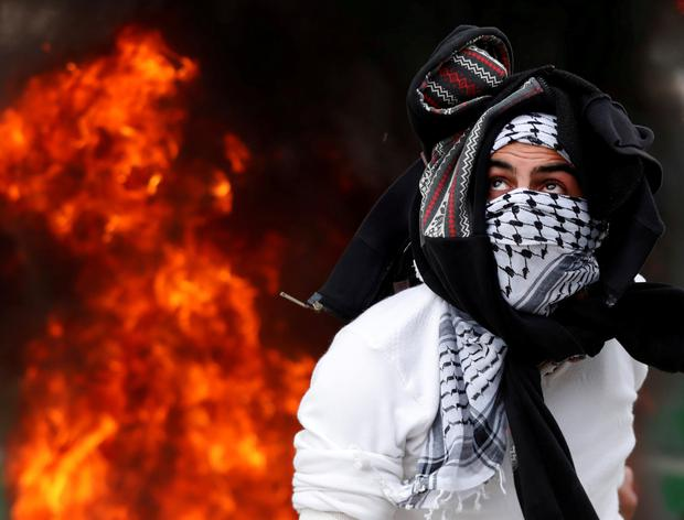 A Palestinian protester during a protest against US President Donald Trump's decision to recognise Jerusalem as the capital of Israel, near Qalandia checkpoint near the West Bank city of Ramallah. Photo: Goran Tomasevic