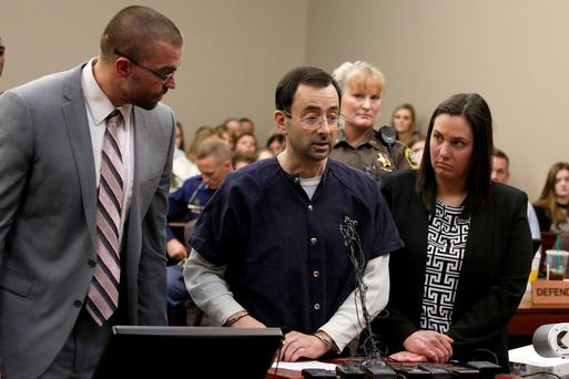 Larry Nassar (centre) makes a statement in the courtroom during his sentencing hearing in Lansing, Michigan, yesterday. REUTERS/Brendan McDermid