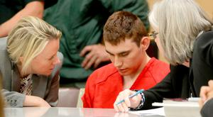 Nikolas Cruz during a brief court appearance yesterday with attorney Melissa McNeil in Fort Lauderdale, Florida. Photo: Getty Images
