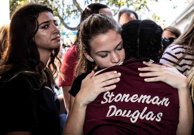 Marjory Stoneman Douglas High School pupils at a memorial after the shooting. Photo: Reuters