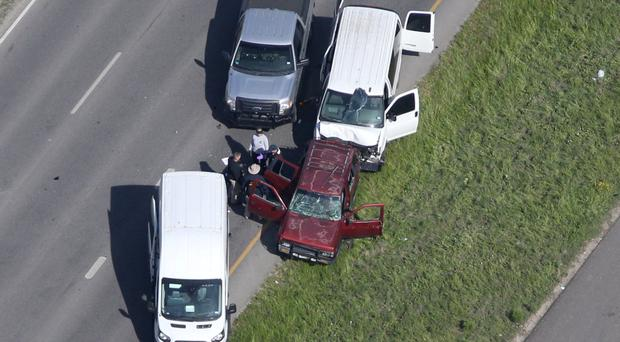 Police investigate the scene where the Texas bombing suspect blew himself up on the side of a highway north of Austin in Round Rock, Texas. Photo: Reuters