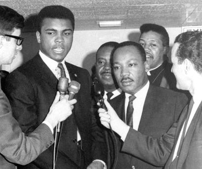 In this March, 1967, photo, heavyweight champion Muhammad Ali, centre left, and Dr Martin Luther King speak to reporters. Photo: AP