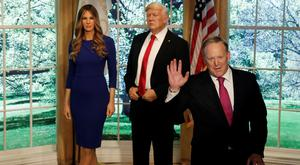 Former White House Press Secretary Sean Spicer poses next to newly unveiled wax figures of US First Lady Melania Trump and President Donald Trump at Madame Tussauds wax museum in New York City yesterday. Photo: Reuters/Mike Segar