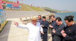 North Korean leader Kim Jong-un inspects the completed railway that connects Koam and Dapchon, in this undated photo released by North Korea's Central News Agency yesterday. Photo: Reuters