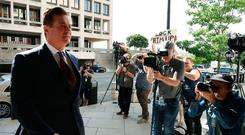 Former Trump campaign manager Paul Manafort arrives at the courthouse in Washington yesterday for a hearing. Photo: Getty Images
