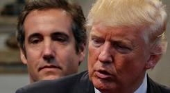 Donald Trump's former personal attorney Michael Cohen stands behind him during an election campaign stop in 2016. Photo: Reuters