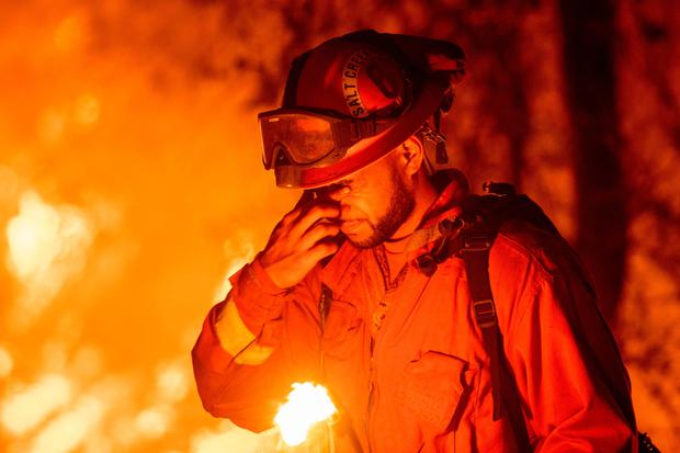 A firefighter tackling the blaze in Redding California which is just one of 88 burning across the United States