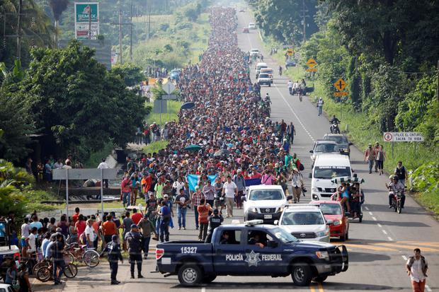 Crowds: Thousands of migrants walk along the highway in Mexico near the border with Guatemala as they head for the US. Photo: Reuters