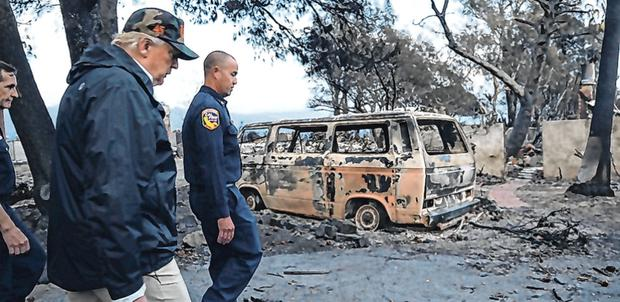 Left: US President Donald Trump visits homes that were ravaged by fire in Malibu, during his trip to the west coast to see first-hand the damage. Photo: REUTERS