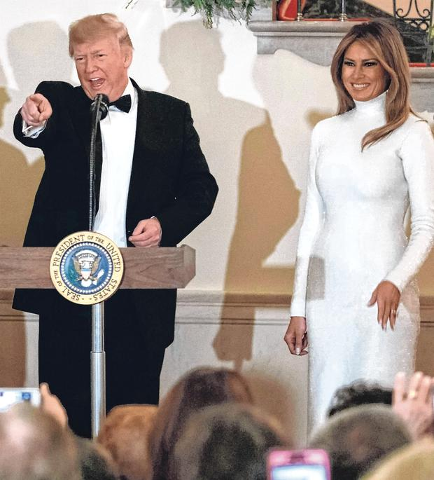 Festive: President Donald Trump with first lady Melania during the Congressional Ball in the grand foyer of the White House. Photo: Carolyn Kaster/AP