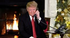 Phone calls: President Trump. Photo: REUTERS
