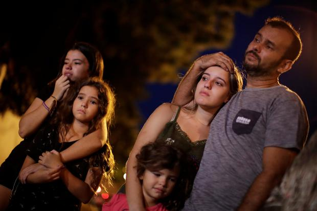 Relatives, friends and students react as they pay tribute to victims of the shooting in Raul Brasil school in Suzano, Sao Paulo state, Brazil. Photo: Reuters/Ueslei Marcelino