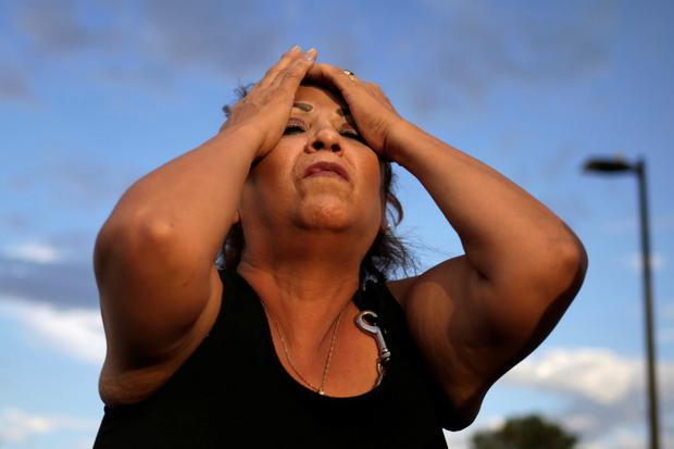 A woman mourns the victims of the mass shooting at a Walmart in El Paso, Texas. Photo: Jose Luis Gonzalez/Reuters