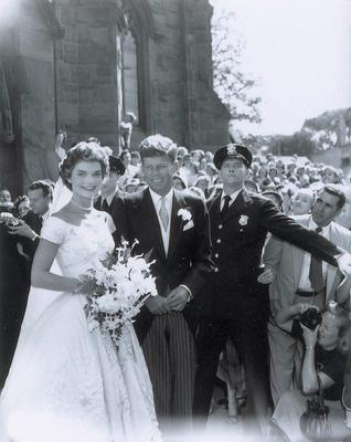 Former US President John F Kennedy with his wife Jacqueline on their wedding day. In Hystopia, JFK survives the assassination attempt in Dallas and goes on to win a third term