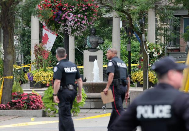 Police officers investigating a mass shooting on Danforth Avenue in Toronto. Photo: Reuters
