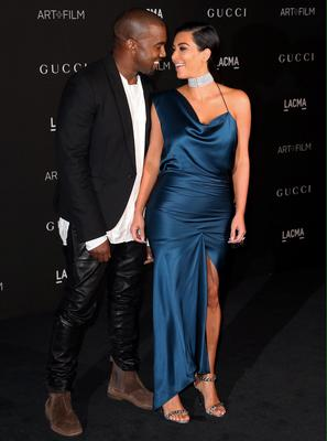 Recording artist Kanye West (L) and Kim Kardashian West attend the 2014 LACMA Art + Film Gala honoring Barbara Kruger and Quentin Tarantino presented by Gucci at LACMA in Los Angeles, California