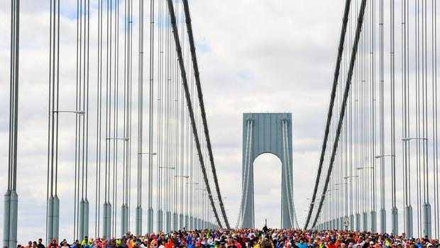 Runners cross the Verrazano-Narrows Bridge at the start of the TCS New York City Marathon in the Brooklyn borough of New York City