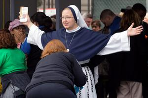 A nun is body-searched as she arrives for the Pope's mass in Philadelphia