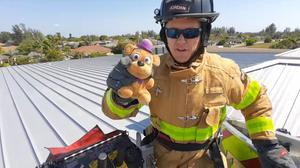Police and fire crews rescued a boy's teddy from the roof of a school (Cape Coral Police Department/PA)