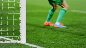 A goalkeeper waits in front of their goal (roibu/Getty Images)