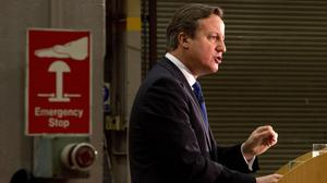 Prime Minister David Cameron delivers a speech on immigration to factory workers and members of the media at JCB World Headquarters in Rocester, Staffordshire.