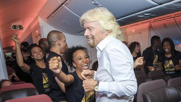 Richard Branson dances with the cast of Motown the Musical on board a flight to Detroit