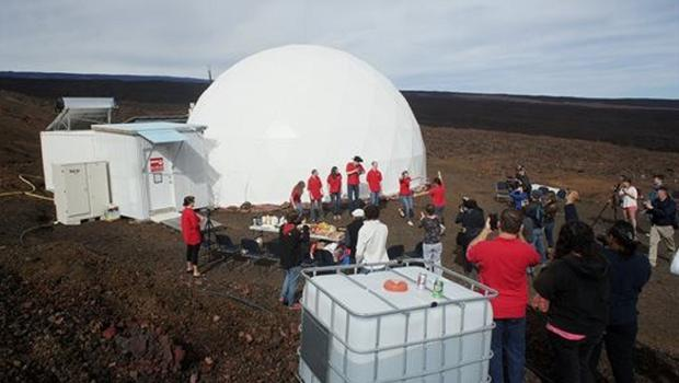 Scientists exit the dome on the bleak slopes of dormant volcano Mauna Loa near Hilo on the Big Island of Hawaii. (Ryan Ogliore/University of Hawaii at Manoa/AP)