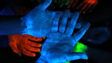 Students at King's College London conduct an experiment for Longitude Prize, using glow gel to highlight remaining bacteria after washing their hands