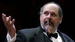 Gary Dryfoos demonstrates the effectiveness of putting cured pork in his nose to stop nosebleeds (AP)