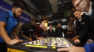 The Duke of Cambridge plays a game of table football at the launch of The Heads Up Weekends at Paddington's Heist Bank, London (Heads Up campaign)