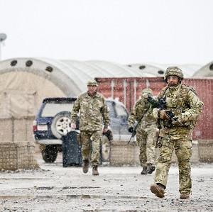 Soldiers of the Royal Military Police with the first proper snowfall in Camp Bastion, Afghanistan, in eight years (PA/MoD)