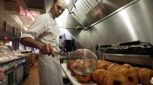 Chef Dominique Ansel makes Cronuts at the Dominique Ansel Bakery. Health officials have closed the bakery due to a severe mouse infestation (AP)