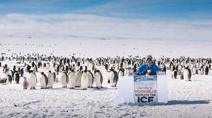 Patrick Woodhead launches his thriller Beneath The Ice in Antarctica in the company of 4,000 emperor penguins (FMCM/PA)