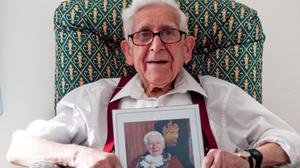 Bernard Jordan, an 89-year-old Second World War veteran, holding a picture of himself as the Mayor of Hove (Gracewell Healthcare)