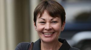 """Caroline Lucas held up a poster demanding """"climate action"""" from the Government during Prime Minister's Questions"""
