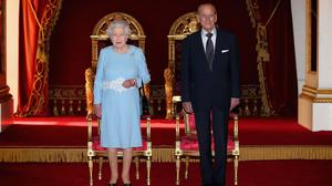 The Queen and the Duke of Edinburgh prepare to present awards for the Queen's Anniversary Prizes for Higher and Further Education at Buckingham Palace in London