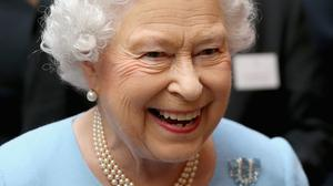 The Queen attending a reception for the Queen's Anniversary Prizes for Higher and Further Education at Buckingham Palace in London